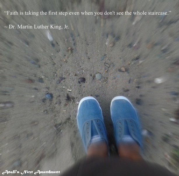 Sneakers on beach with quote