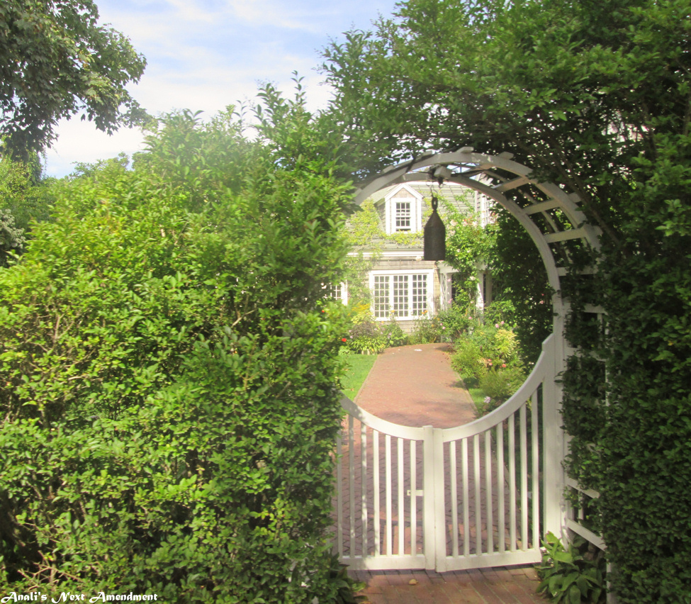 Nantucket house through the fence