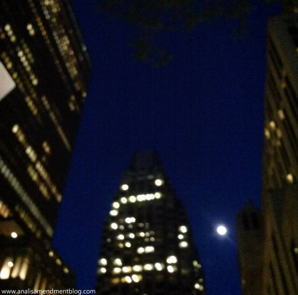 moonrise in Boston against skyscrapers