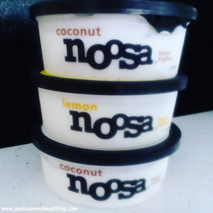 Picture of three stacked containers of Noosa yogurt.