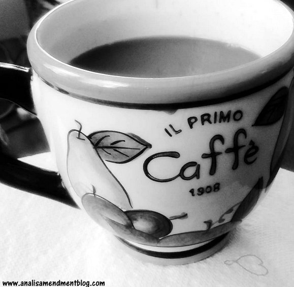 Black and white photo of coffee cup, filled with coffee being enjoyed on Sunday..